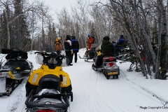 Riders gather to enjoy the view of Cowley Lake on the 2017 Take a Friend Snowmobiling Ride
