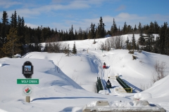 Sledders crossing the Peter Greenlaw Memorial Bridge over Wolf Creek - March 2012