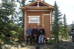 K.S.A. Volunteers putting the finishing touches on the warmup cabin on the Dawson Overland Trail - September 2005