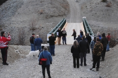 Deb Greenlaw cutting the ribbon at the Grand Opening of the Peter Greenlaw Memorial Bridge over Wolf Creek on the Copper Haul Trail  -  October 2011
