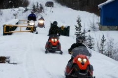 Sledders cross the Rodney Cox Memorial Bridge on the K.S.A.'s Annual Take a Friend Snowmobiling Ride - February 2017