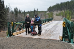 Linda Cox cutting the ribbon to open the Rodney Cox Memorial Bridge, with help from Harris and the Mayor - October 2012