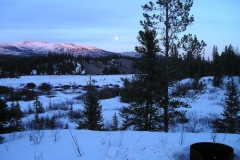 Sunset at the K.S.A. warmup cabin on the Dawson Overland Trail  -  March 2005